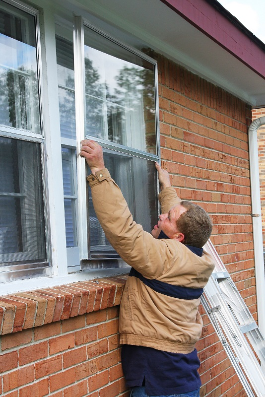 storm windows being installed