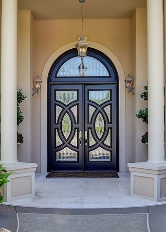 Suburban Luxury House With Column Porch And Arched Entrance Door
